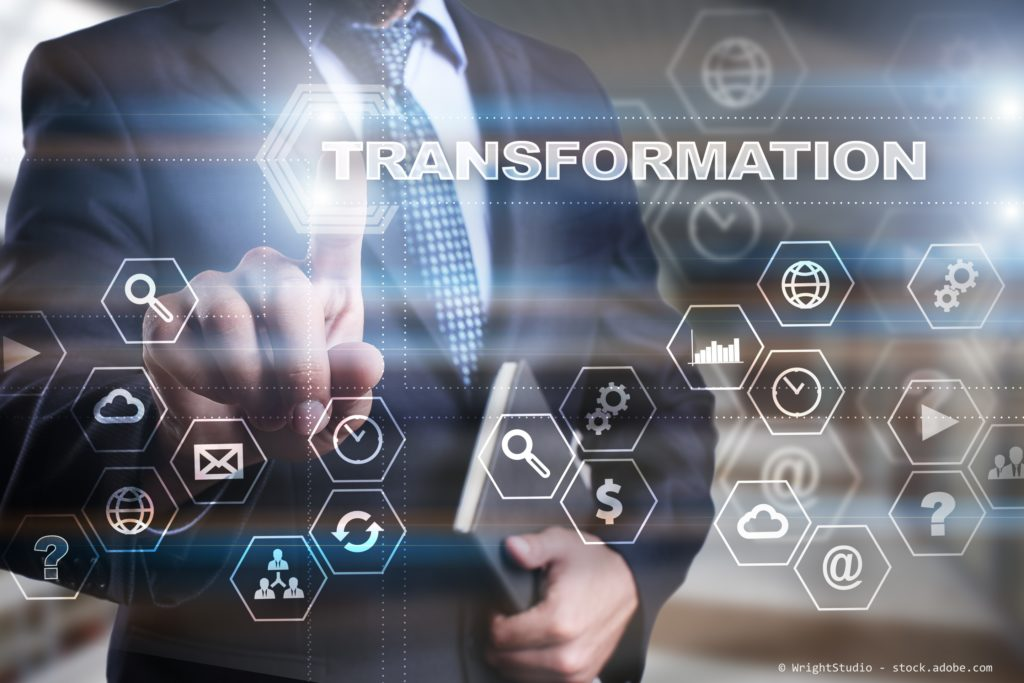 """Businessman is pressing on the virtual screen and selecting """"Transformation""""."""